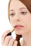 放置唇膏的少妇  免版税库存图片