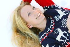 放置在冬天雪的妇女 免版税库存图片