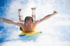放置在冲浪板的人 免版税图库摄影