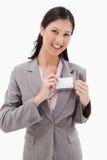 放置在姓名徽章的微笑的女实业家 免版税图库摄影