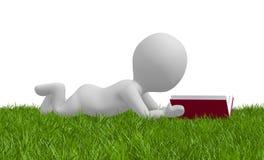 放置在草和读书的动画片人 库存照片