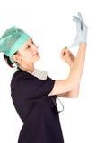 放置外科医生年轻人的女性手套乳汁 库存图片