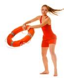 救生员当班与lifebuoy的救生圈 库存照片