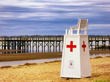 救生员抢救在核桃海滩的立场椅子 库存照片
