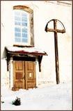 教会侧门门在冬天 库存图片