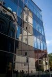 教会反映城镇 免版税图库摄影