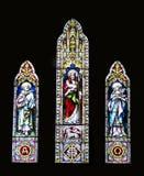 教会玻璃弄脏了三视窗 免版税库存照片