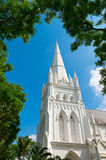 教会的高塔塔楼在蓝天下 免版税图库摄影