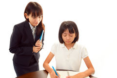 教育女孩和教师 免版税库存图片