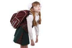 教育女小学生疲倦了 免版税图库摄影