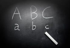 教育概念在黑板的ABC字母表 免版税图库摄影
