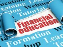教育概念:红色在被撕毁的纸下张的文本财政教育  图库摄影