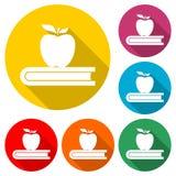 教育象,书用苹果,与长的阴影的颜色象 库存图片