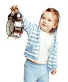 敞篷的小逗人喜爱的女孩有时钟警报藏品的 库存照片