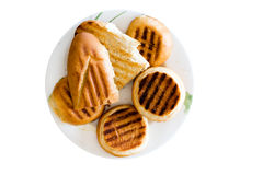 敬酒的小圆面包和长方形宝石板材  免版税库存图片