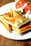敬酒的干酪三明治 免版税库存图片
