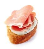 敬酒的面包用熏制的肉 库存图片