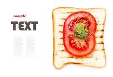 敬酒面包、蕃茄和草本,隔绝在白色背景,克洛 免版税图库摄影