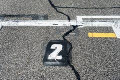 数字二段式在开始轨道的赛车场 免版税库存照片