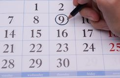 数字和手有铅笔的 免版税库存图片