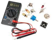 数字式多用电表和无线电组分 图库摄影
