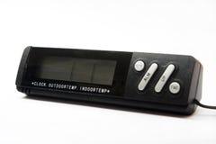 黑数字钟和一个数字体温计 库存图片
