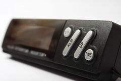 黑数字钟和一个数字体温计 图库摄影