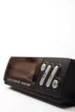 黑数字钟和一个数字体温计 免版税图库摄影