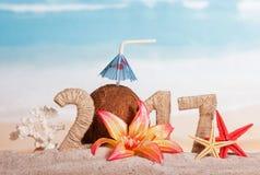数字217缠绕了与麻线、椰子、海星和珊瑚,流程 免版税库存图片
