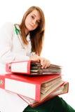 文书工作 有文件的劳累过度的医生妇女 免版税图库摄影