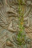 文化garuda kencana公园wisnu 有一个浮雕象岩石的墙壁  巴厘岛 印度尼西亚 免版税图库摄影