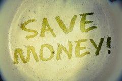 文字笔记陈列保存金钱诱导电话 陈列减少费用的企业照片由earningsIdeas做一笔资金弄乱 免版税图库摄影