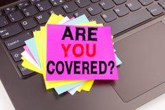 文字问题是您报道了在办公室特写镜头做的文本在便携式计算机键盘 旅行保险的H企业概念 免版税库存图片