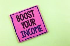 文本标志陈列助力您的收入 概念性照片改进您的付款做自由职业者的半日工作在桃红色棍子写Improve 免版税库存照片