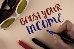 文本标志陈列助力您的收入 E 库存图片
