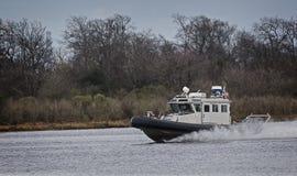 文职机关工作的海洋河巡逻艇 免版税库存照片