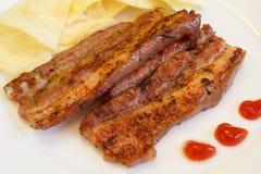 斑斑烤的猪肉 库存图片