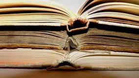 斜向一边三本的旧书被转动 免版税库存照片
