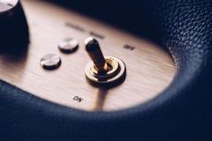 断断续续的金属金子被镀的开关 免版税库存照片
