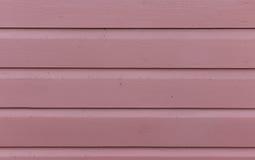 斯堪的纳维亚木纹理在红紫罗兰色-纹理-背景& x28中; 波尔沃, Finland& x29历史的老镇; 库存照片