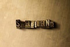 斯威士兰-脏的葡萄酒在金属背景的被排版的词特写镜头  免版税库存图片