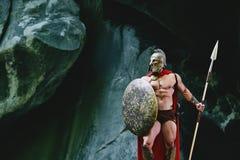 斯巴达战士在森林 免版税库存图片