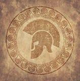 斯巴达盔甲在老纸的一个象在样式难看的东西,在古色古香的希腊样式被发布 免版税库存照片