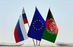 斯洛文尼亚欧盟和阿富汗的旗子 免版税图库摄影