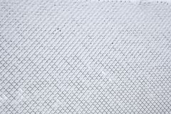 斯诺伊作为背景的篱芭网 免版税库存图片