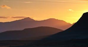 斯诺登山日落 免版税库存图片