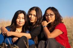 新亚裔逗人喜爱的妇女 免版税库存照片