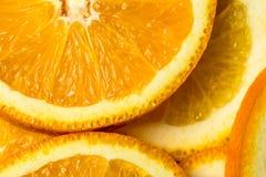 新伐橙色果子背景,桔子,宏指令接近的照片许多片断  库存图片