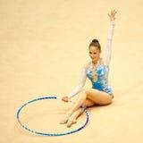 新体操运动员Irina Deleanu桔子战利品 免版税图库摄影