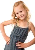 新俏丽的女孩用在臀部的现有量 免版税库存照片